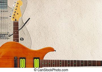 Mahogany and grey electric guitars and headstock on rough...