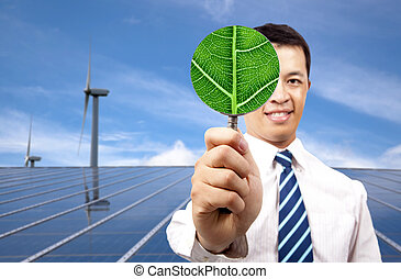 green energy business concept.young businessman holding...