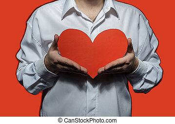 Male white shirt that holding a big red heart. Valentine's...