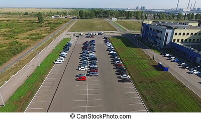 Video from drone that flies along the parking. A large...