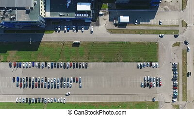 Aerial view of the a capacious parking with different...