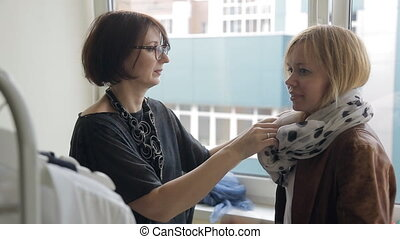 Stylist shows to purchaser how correct tie volume silk...