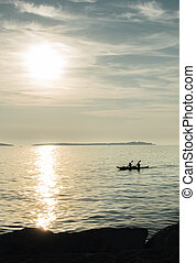 Canoe on Sea at Sunset