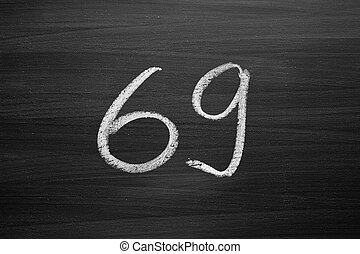 number sixty nine enumeration written with a chalk on the...