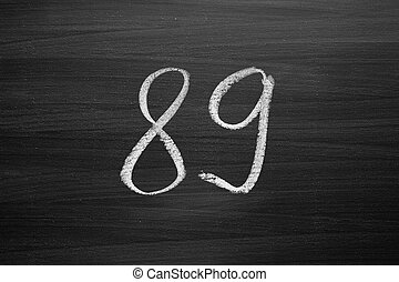 number eighty nine enumeration written with a chalk on the...