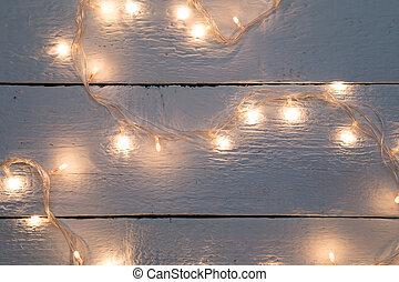 Christmas festoon on wooden floor - Christmas festoon on...