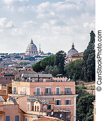 Roofs of Rome and the dome of St. Peter's Basilica