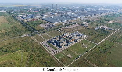 Aerial survey of a industrial city. Many green spaces near...