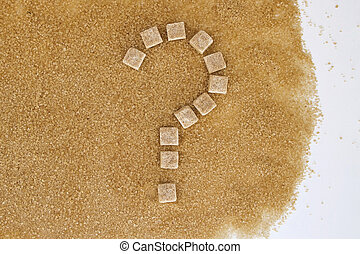 Background of brown sugar cubes shaped as a question mark....