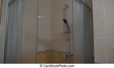 Standard shower stall, handy for showering after a hard...