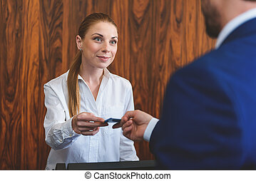 Female hotel manager welcoming businessman - This is your...