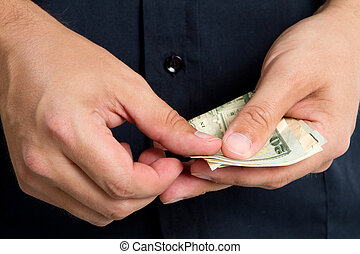 Paying Money - Close up of man's hands as he starts to count...