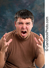 Enraged Man - Enraged man who is close to tears, screams and...