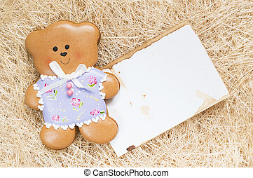 Background with a honey-cake bear - A straw background with...