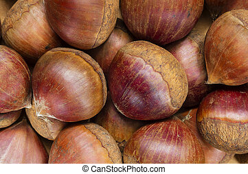 Raw chestnuts background - A background with lots of fresh...