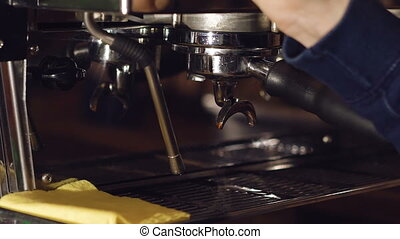 Barista preparing beverage in coffee maker. Full HD