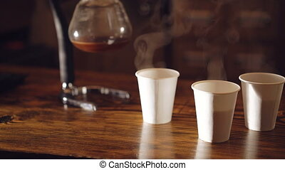 Coffee evaporating in glasses on the table in 4K