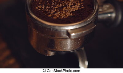 Close up of coffee grounds in vessel of coffee maker. Full...