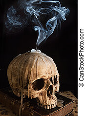 Candle on skull 7 - Halloween image with a smoking candle on...
