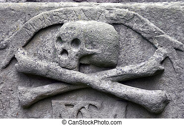 Crossbones on a grave - Crossbones carved in a tombstone