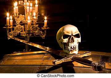 Halloween pirate - Spooky skull and sword lit by candles