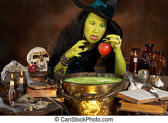 Snowwhites apple - Green halloween witch putting a red apple...