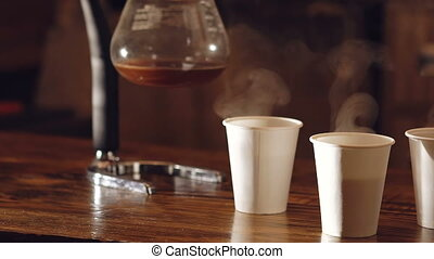 Three cups of delicious coffee on the wooden table