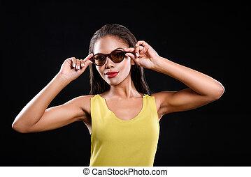 Joyful woman is wearing sunglasses