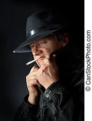Smoking mafia guy - Mafia type with scar on his hand,...