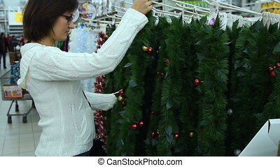 Woman buying Christmas decorations in the store - Young...