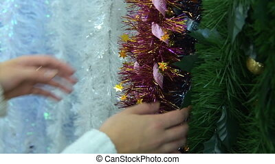 Buying Christmas tinsel in the shop - Close-up shot of woman...