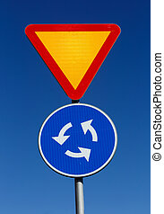 Give way at rhe roundabout - Road signs give way and...
