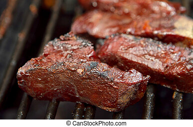 bbq ribs - barbecue beef spare ribs cooking on a grill...