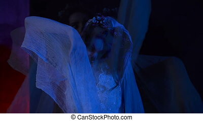 Horror scene from the film with dead girl in white wedding...
