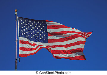 United States of America flag waving in clear sky