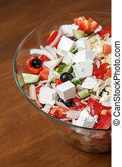 Fresh greek salad with feta cheese in a big bowl