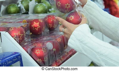 Woman buying Christmas tree decorations in the store - Woman...
