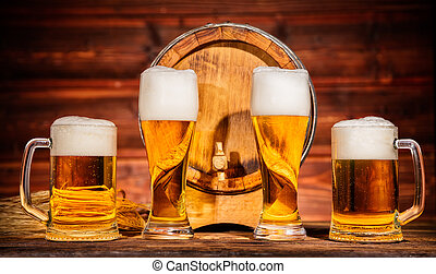 Glasses of lager with old wooden keg - Various glasses of...