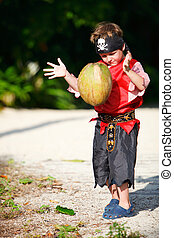 Boy dressed as pirate with coconut