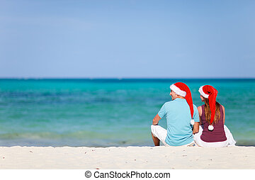 Young couple on Christmas beach vacation - Young couple...