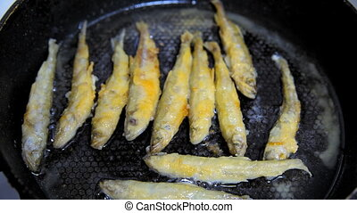 Fish fried in a skillet. Smelt. - Fish fried in a skillet....