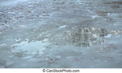 Two kids jumping in spring icy puddle, slow motion 250 fps -...