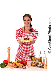 Woman cooking spaghetti - Attractive Young woman displaying...