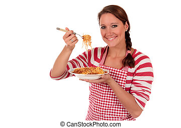 Woman cooking spaghetti - Attractive Young woman tasting...