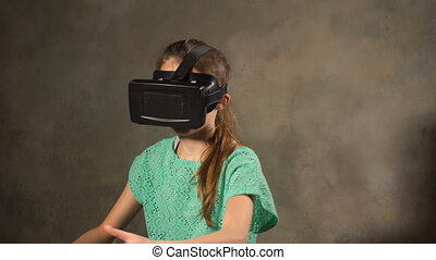 Teen young girl with VR headset. Looking around in 3d...