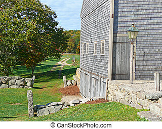 farm land - cape cod farm with dirt road in background green...