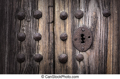 old paneled wooden door - Keyhole in an old paneled wooden...