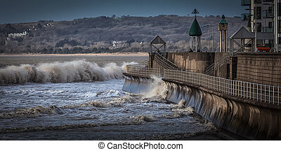 Swansea Bay promenade - High tide and wind batter the...