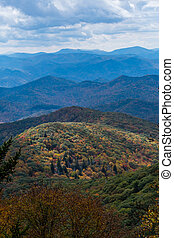Light Highlights a Lower Mountain Covered in Fall Colors...