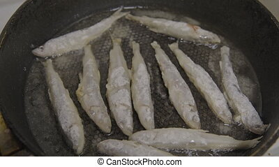 Fish fried in a skillet. Smelt. S-log.